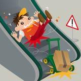 Un livreur négligent glissant sur l'escalator Photographie stock libre de droits