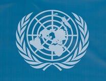 UN logo. A white UN logo on a blue background Stock Image