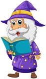 Un magicien tenant un livre Images stock