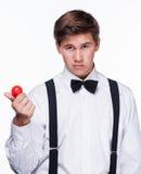 Un magicien tenant une boule magique Images stock