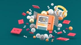 Un magnetófono anaranjado rodeado por las cintas y las bolas coloridas en un fondo verde fotografía de archivo libre de regalías