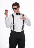 Un mago que sostiene bolas mágicas Foto de archivo