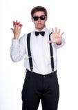 Un mago que sostiene bolas mágicas Imágenes de archivo libres de regalías
