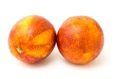 Un mandarino di due rossi su un bianco Fotografie Stock Libere da Diritti