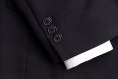 Un manicotto del vestito con un polsino bianco Fotografia Stock Libera da Diritti