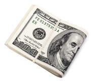 Notas aisladas de Folded100 USD Fotos de archivo libres de regalías