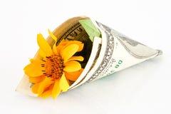 Un manojo de dinero y de flores Imágenes de archivo libres de regalías