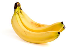 Un manojo de tres plátanos amarillos maduros Imagen de archivo libre de regalías