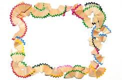 Un marco colorido consiste en virutas del lápiz Foto de archivo libre de regalías