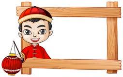 Un marco con un muchacho chino sonriente Fotografía de archivo