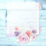 Un marco cuadrado, un lugar para el texto con las flores de papel, un pétalo en un fondo de madera Imagen de archivo