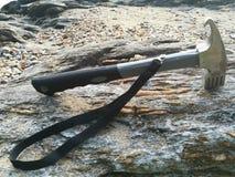 Un martillo en la playa fotografía de archivo libre de regalías