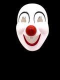Un masque de joker sur le fond noir image stock