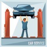 Un meccanico in vestito blu che ripara un'automobile blu Fotografia Stock