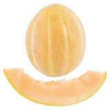 Un melón entero y un pedazo de melón cortado Fotografía de archivo libre de regalías