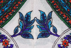 Un modèle floral sur le tissu sous forme de diamant et de St Photo libre de droits