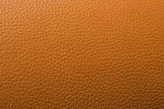 Un modello di cuoio arancio del fondo Immagini Stock