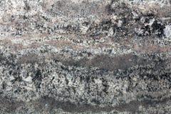 Un modello naturale di una superficie della pietra del granito Fotografie Stock Libere da Diritti