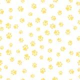 Un modelo de las pistas caninas de diversos tamaños Las pistas del perro son amarillas en un fondo blanco Ejemplo del vector en u Fotos de archivo libres de regalías