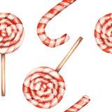 Un modelo dulce inconsútil con la piruleta de la acuarela (bastón de caramelo) Pintado a mano en un fondo blanco Foto de archivo libre de regalías