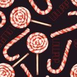 Un modelo dulce inconsútil con la piruleta de la acuarela (bastón de caramelo) Pintado a mano en un fondo negro Fotos de archivo libres de regalías