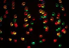 Un modelo ligero del bokeh de elementos geométricos en un fondo oscuro fotos de archivo