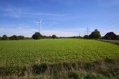 Un molino de viento en una imagen del paisaje foto de archivo libre de regalías