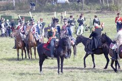 Un moment de bataille Cavaliers de cheval sur le champ de bataille Image stock