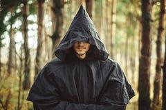 Un monaco nel cappuccio fotografia stock