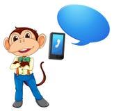 Un mono con el teléfono celular Imágenes de archivo libres de regalías