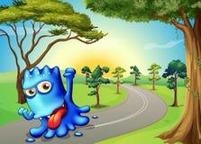 Un monstre bleu courant avec un sourire Photographie stock