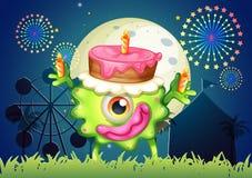 Un monstre célébrant un anniversaire près du carnaval Photos libres de droits