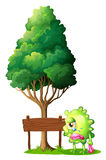 Un monstre vert pleurant près de l'enseigne en bois vide Photographie stock libre de droits