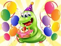 Un monstruo feliz rodeado con los globos Foto de archivo libre de regalías