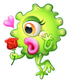 Un monstruo femenino que sostiene una rosa Imagen de archivo libre de regalías