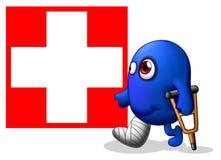 Un monstruo herido cerca de la señalización de la Cruz Roja Imagenes de archivo