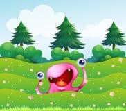 Un monstruo rosado cerca de los árboles de pino Fotografía de archivo