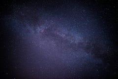 Un montón negro del cielo nocturno de estrellas con Imagen de archivo