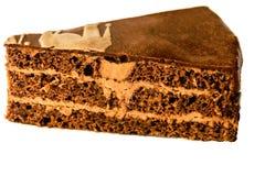Un morceau de gâteau est isolé sur un fond blanc photographie stock libre de droits