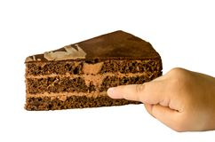 Un morceau de gâteau et d'une main image libre de droits