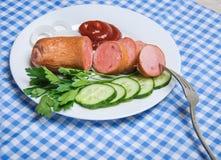 Un morceau de saucisse sur une fourchette Photographie stock libre de droits