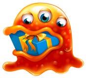 Un mostro che inghiotte un regalo Fotografia Stock