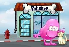 Un mostro rosa del beanie e un animale domestico davanti al negozio di animali Immagini Stock