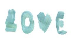 Un mot de l'amour écrit en peinture à l'huile bleue sur un fond blanc, fait main Images libres de droits