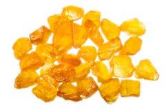 Un mucchio degli zaffiri gialli non tagliati ruvidi Fotografie Stock