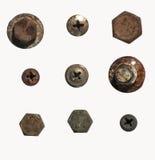 Un mucchio dei dadi, dei bulloni, delle viti e di altri fermi su un fondo bianco Fotografia Stock Libera da Diritti