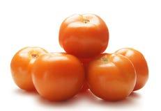 Un mucchio dei pomodori rossi freschi su bianco Fotografie Stock