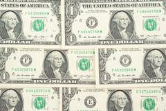 Un mucchio delle banconote da un dollaro americano come fondo dei soldi del dollaro Immagini Stock Libere da Diritti