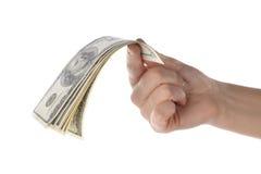 Un mucchio di 100 banconote del dollaro sulla mano femminile Fotografie Stock Libere da Diritti