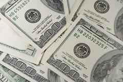 Un mucchio di cento banconote in dollari Fotografia Stock Libera da Diritti